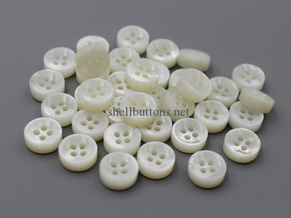double white MOP buttons with concave face