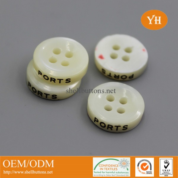 engraved trocas/trochus shell buttons with brand logo