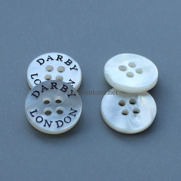 shell buttons with oiling logo