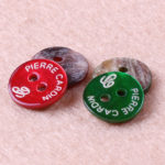 colored shell buttons with logo